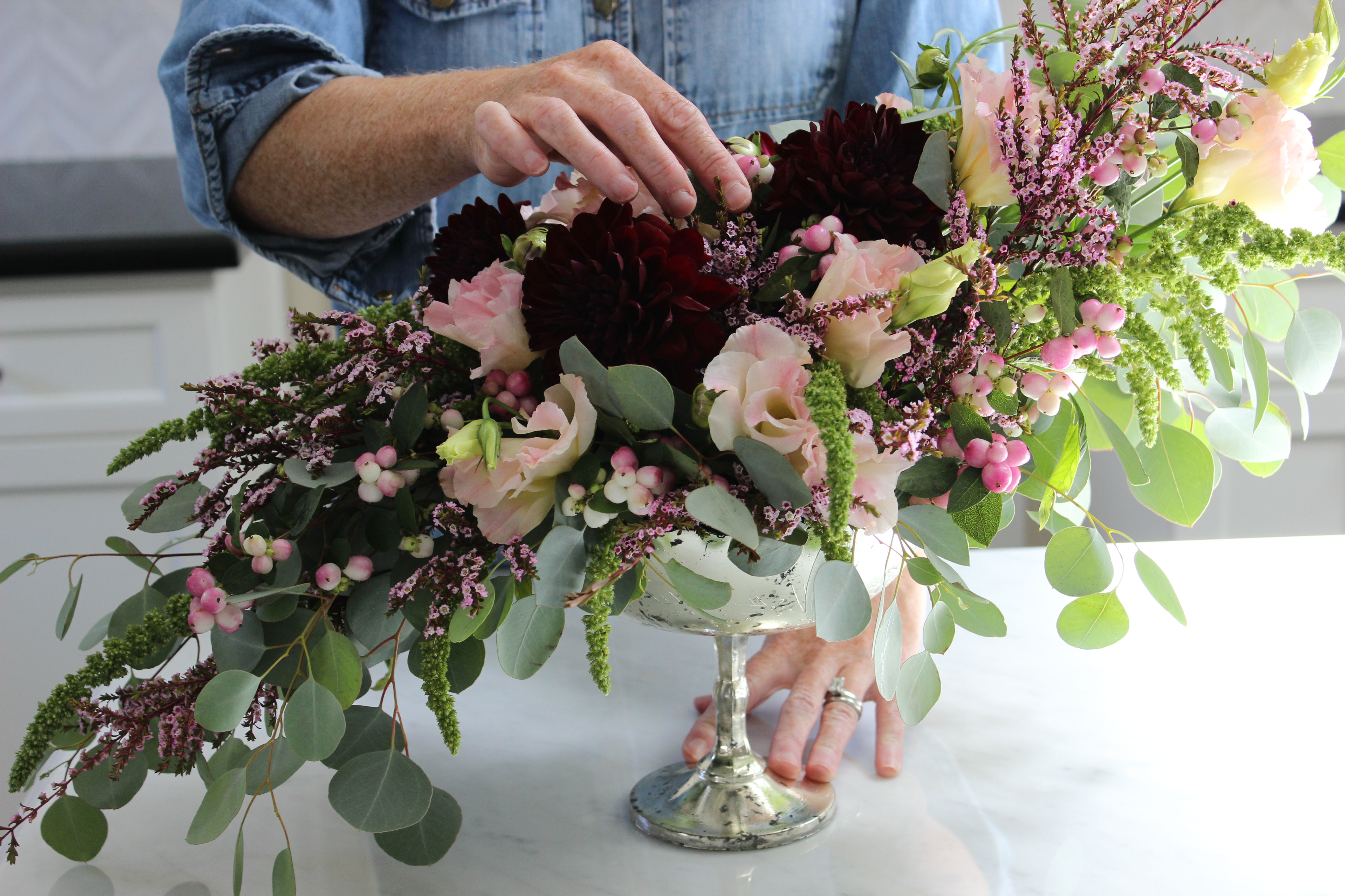 How to make an asymmetrical flower arrangement jane can after we were satisfied with the filler we began to place the primary flower we chose dahilas because they are currently in season are available in izmirmasajfo