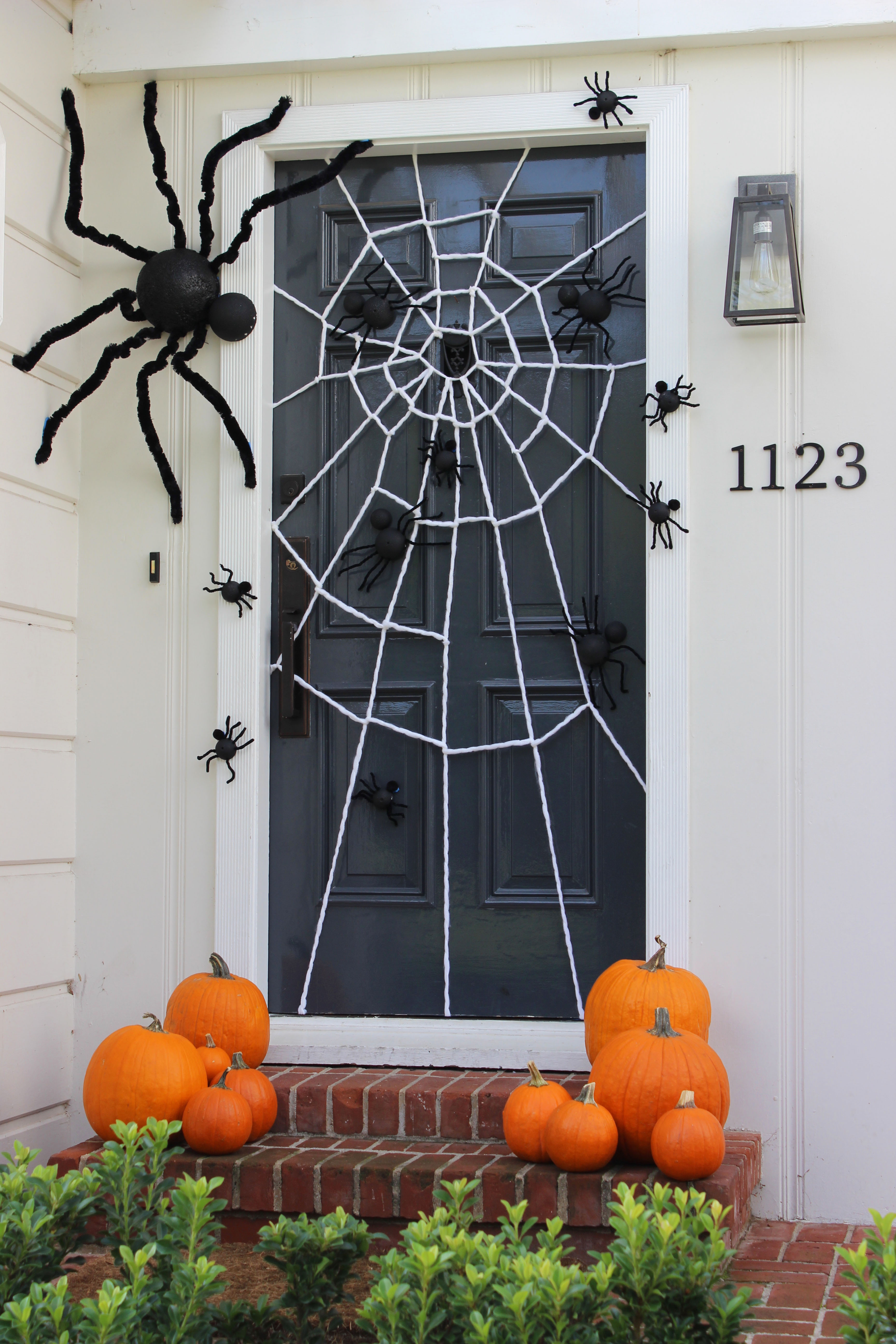 for our halloween door we created a gigantic spider web crawling with spiders large and small to create the spider web we used extra thick white yarn like